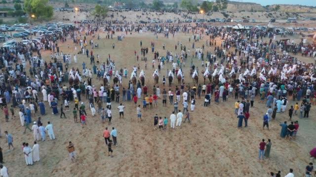 corsa di cavalli tradizionale in libia - libia video stock e b–roll