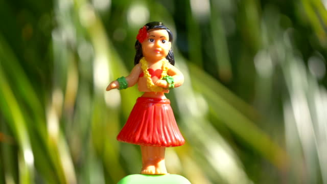 Traditional hula dancer souvenir toy in 4K Professional video of traditional hula dancer souvenir toy in 4K slow motion 60fps souvenir stock videos & royalty-free footage