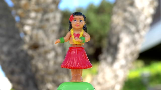 Traditional hula dancer souvenir toy in 4K Professional video of traditional hula dancer souvenir toy in 4K slow motion 60fps doll stock videos & royalty-free footage