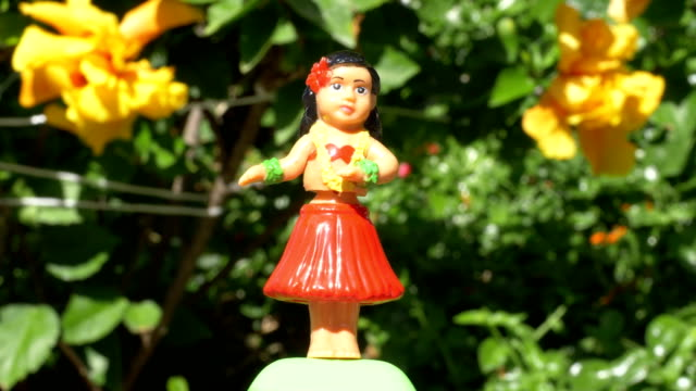 Traditional hula dancer souvenir toy in 4K video