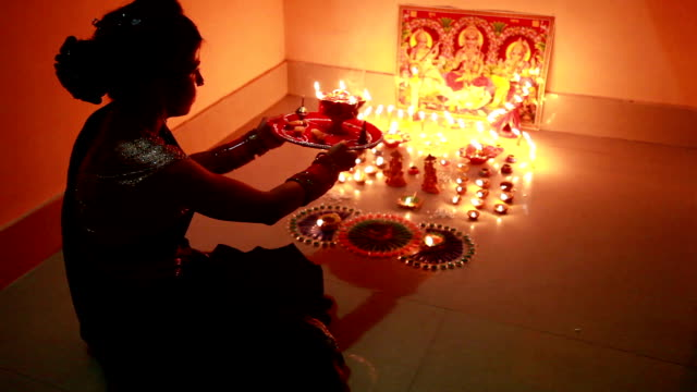 Traditional Indian woman worshiping Lakshmi on Diwali festival video