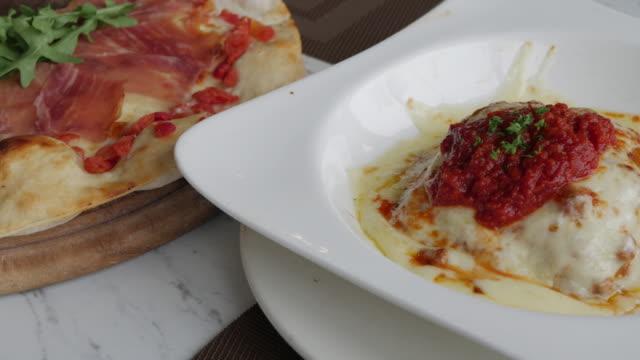 Traditional Italian beef lasagne. Traditional Italian beef lasagne serving on white plate in restaurant. menu stock videos & royalty-free footage