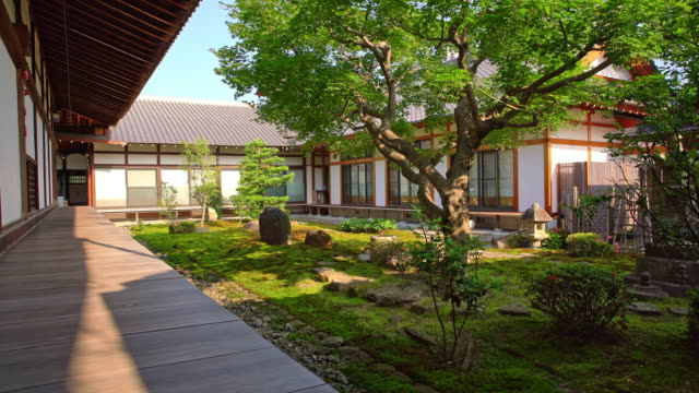 DS Traditional Japanese house with the garden Dolly shot of a beautiful Japanese garden in the back of the house. Also available in 4K resolution ornamental garden stock videos & royalty-free footage