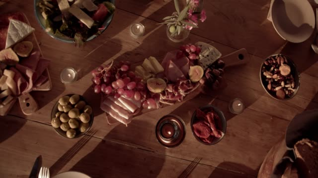 Traditional mediterranean dinner table with cheese and fruit platters video