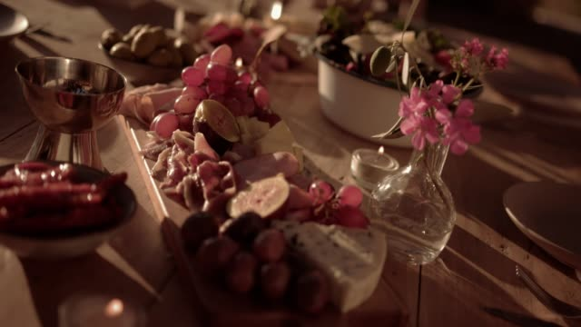 Traditional mediterranean dinner table with French cheese and fruit platters video