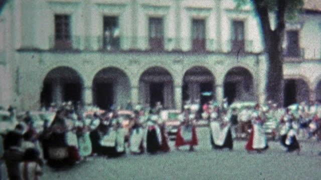 1974: traditionelle einheimische tanz auf den city square für festliche veranstaltungen. - editorial videos stock-videos und b-roll-filmmaterial