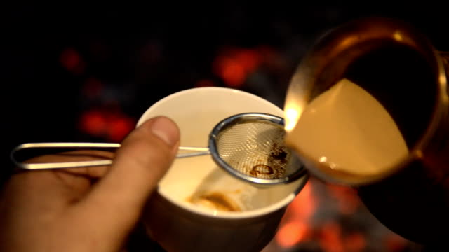 Traditional process boil Turkish coffee on coals.