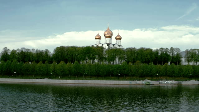 Traditional Russian Church on the river shore in spring in a daytime video
