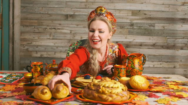 Traditional Russian Karavai Holiday Bread A Russian woman with a traditional Russian karavai holiday bread on a table. russian culture stock videos & royalty-free footage