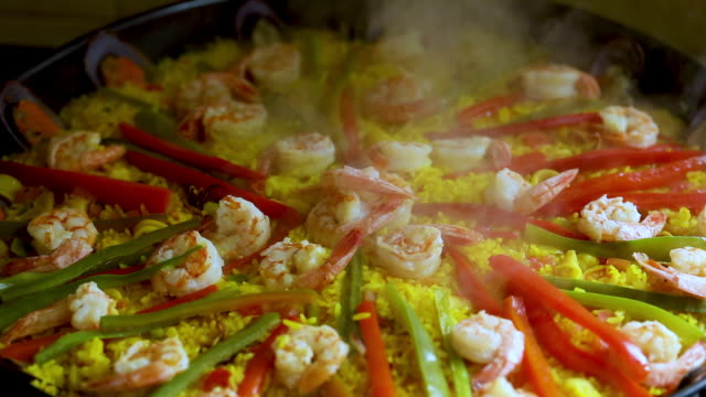 Traditional seafood paella in the fry pan