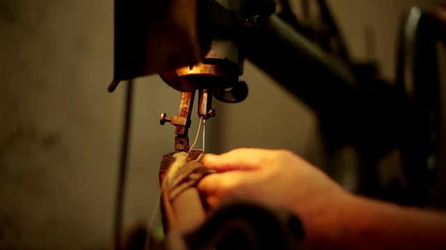 traditional shoemaker sews the sewing machine - läder bildbanksvideor och videomaterial från bakom kulisserna