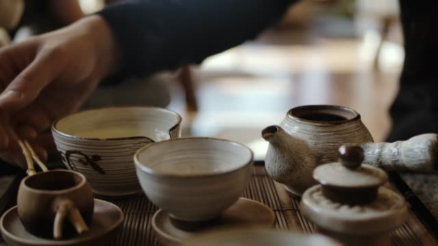 Traditional Tea making - Pouring Black Tea into Cup