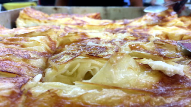 Traditional Turkish Pancake Borek, hot cheese pancake, watery Turkish food borek on a big tray, pastry with cheese, flour baked salty cheese borek, freshly baked hot cheese borek, watery pancake Turkey turkish culture stock videos & royalty-free footage