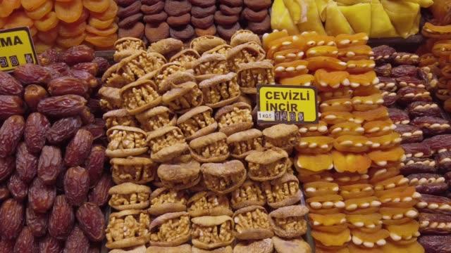 traditional turkish sweet food in an old bazaar in istanbul, turkey - grand bazaar video stock e b–roll