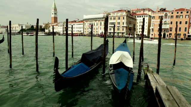 Traditional Venetian gondolas rocking on the waters of the channel video