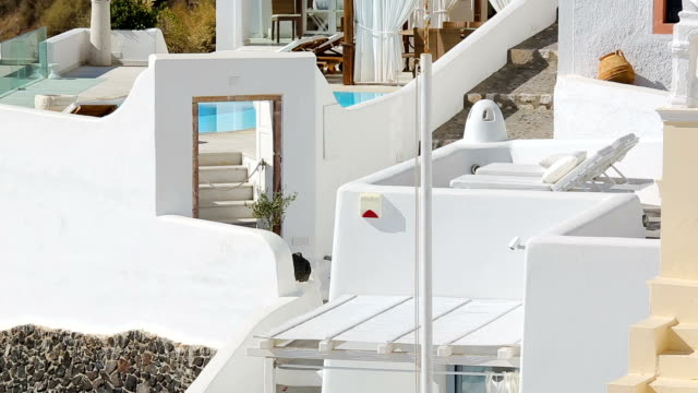 Traditional whitewashed architecture of Santorini decorated with ancient pottery