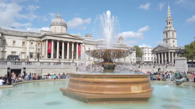 Trafalgar Square fountain and British National Gallery. Fountain in Trafalgar Square, London, with the National Gallery entrance in the background. fountains stock videos & royalty-free footage