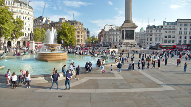 Trafalgar Square. London city. Fountain. People. Tourist. Travel Destination. In background Red Bus. Big Ben