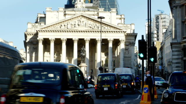 T/L Traffic Around Royal Exchange In London City (4K/UHD to HD) video