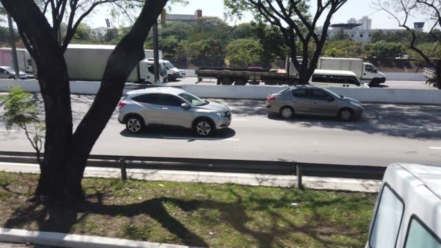Traffic at Marginal Tiete in Sao Paulo city. Video of traffic at Marginal Tiete in Sao Paulo city. marginal tiete highway stock videos & royalty-free footage