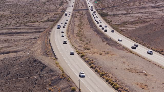 Traffic Between Las Vegas and Los Angeles on I-15 Near Zzyzx - Drone Shot Drone shot of Interstate 15, a divided highway crossing the Mojave Desert near the town of Zzyzx. mojave desert stock videos & royalty-free footage