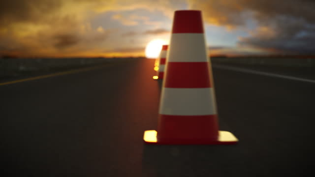Traffic cone endless slalom in sunset. Car on highway . video