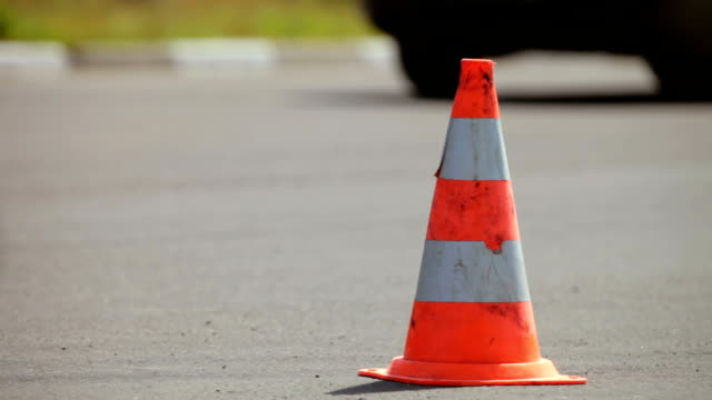 Traffic cone Traffic cone in the background moving cars time zone stock videos & royalty-free footage