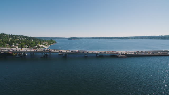 Traffic Crossing Floating Bridge Over Lake Washington From Bellevue to Seattle Aerial Shot