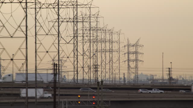 Traffic driving over Los Angeles bridges with power cables overhead HD video