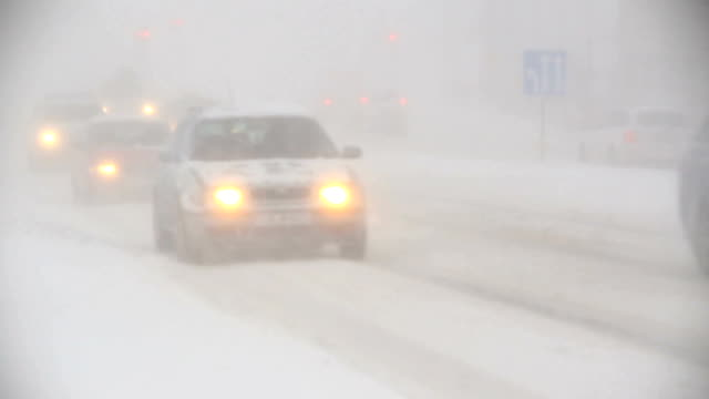 traffic glowing headlights in heavy blizzard, zero visibility whiteout, Reykjavik, Iceland video
