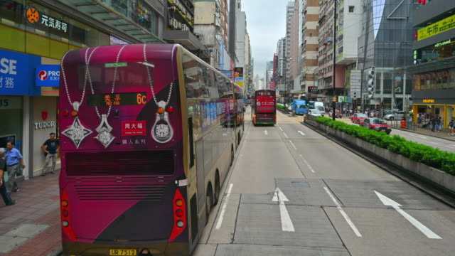 traffic in city at day time . view from double-decker tram on street of hk timelapse - центральный район стоковые видео и кадры b-roll