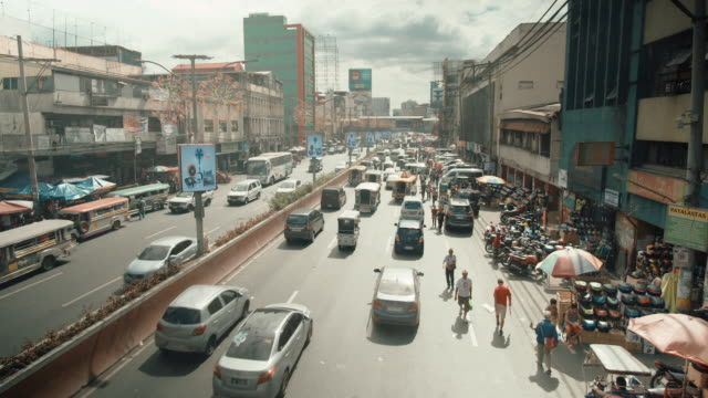 vídeos de stock e filmes b-roll de traffic in manila, philippines - etnia filipina