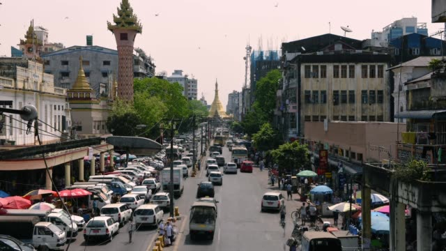 traffic jam near sula pagoda which is located in the heart of downtown yangon, myanmar - myanmar video stock e b–roll