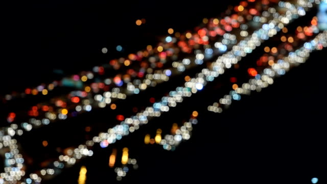Traffic jam on highway at night with defocused light mode - fast motion video