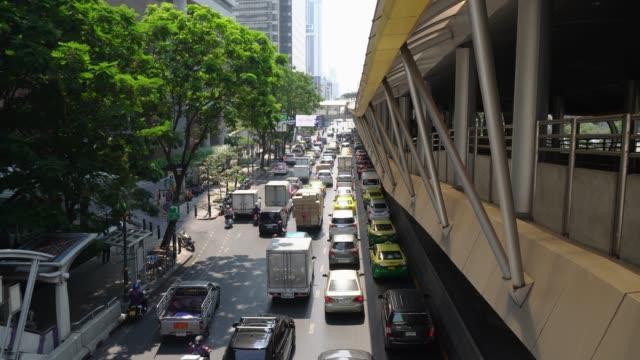 Traffic jam on Sathorn Road at electric train Chong nonsi station rush hours bangkok thailand