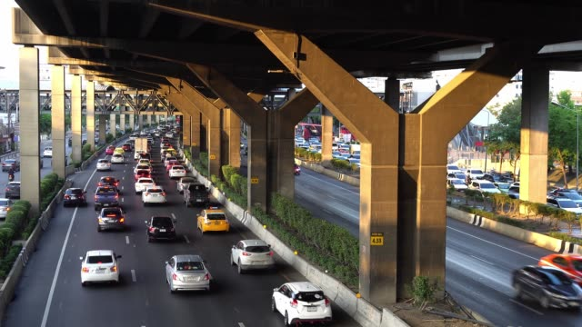Traffic jam on Vibhavadi Rangsit Road evening with sunlight in Bangkok, Thailand.