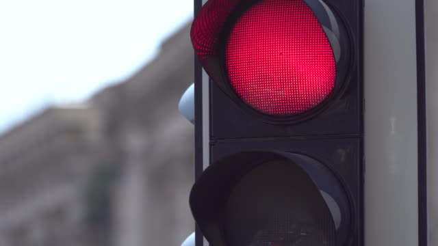 A traffic light above the road regulates the road. Close-up. Change the traffic lights. Traffic regulations and driving safety