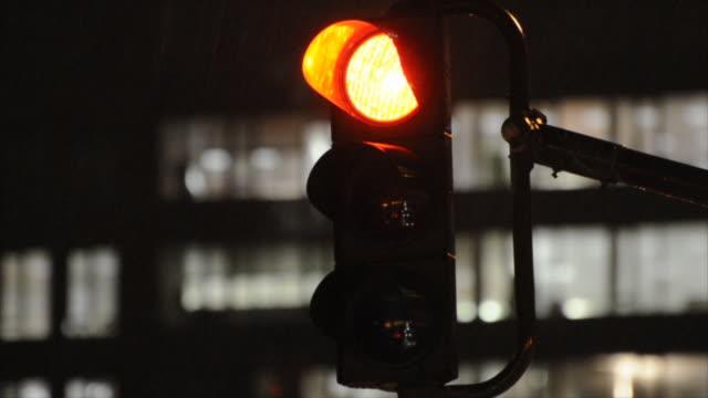 Traffic light at night, turning green (HD720p)
