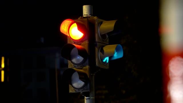 Traffic light at night Red light on traffic light// 4K 3840x2160 / 29.97p / Photo-JPEG / Real Time stoplight stock videos & royalty-free footage