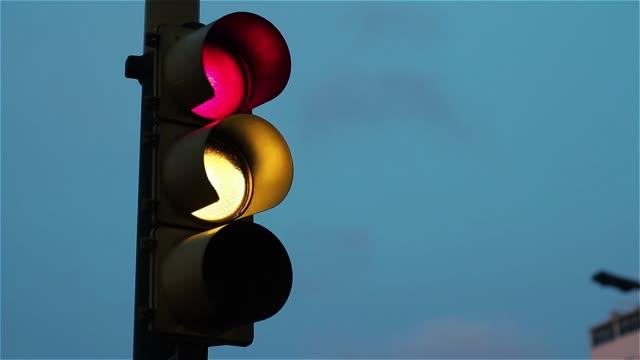 Traffic Light At Sunset.