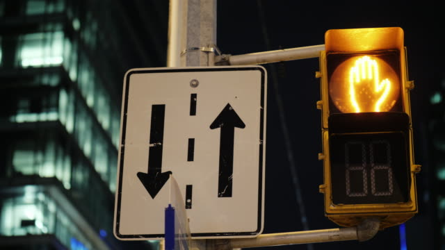 Traffic light for pedestrians with a countdown. Evening Toronto, Canada video