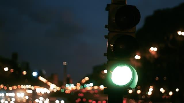 Traffic Light in 9 de Julio Avenue at Night, Buenos Aires, Argentina.