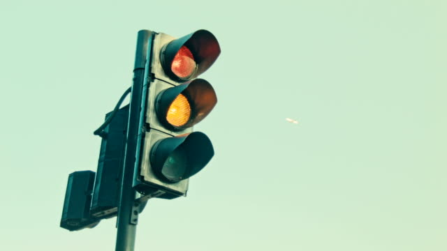 Traffic light, plane in the background video