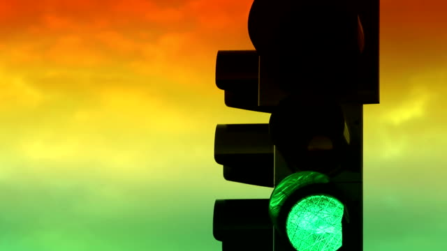 Traffic light with colorful sky timelapse on a background video