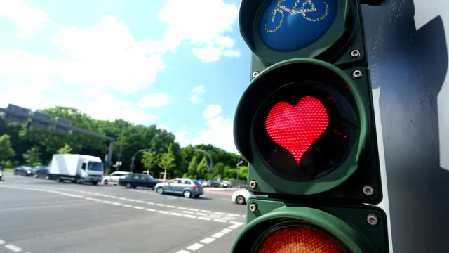 Traffic light with heart shaped red lamp video