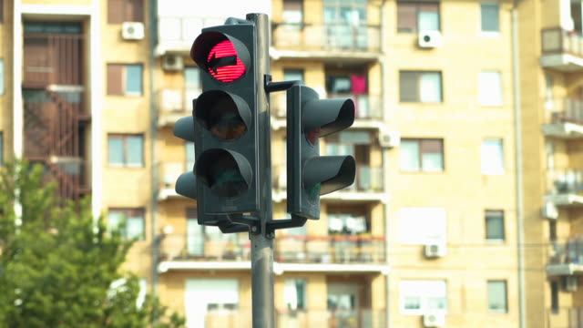 Traffic lights work in a big city at a crossroads