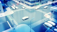 istock Traffic Lights Working at Crossroad in Modern Night City Abstract Illustration. Beautiful 3d Animation of Car Traffic on the Stylized Streets. DOF Blur. 1175717880