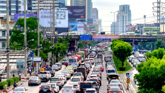 Traffic moves slowly along a busy road in Bangkok, Thailand. video