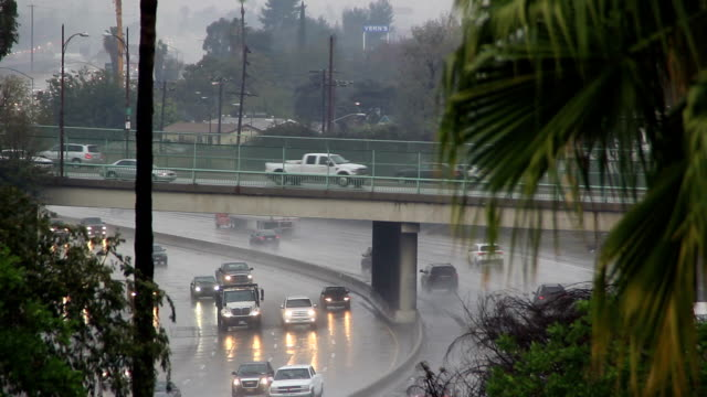 Traffic moving on freeway during heavy rain video