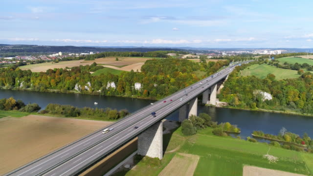 Traffic on Autobahn Bridge over the Danube River near Regensburg Aerial shot made from drone point of view. 4K/Ultra High Definition autobahn stock videos & royalty-free footage